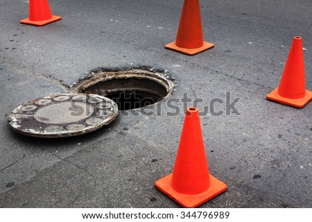 open manhole and repair of roads - stock photo