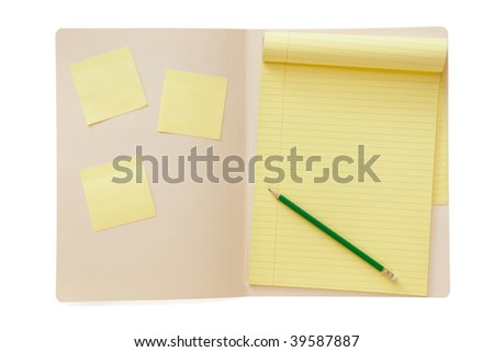 Open manila folder, with yellow lined notepad and pencil, and sticky notes.  Clipping path included. - stock photo