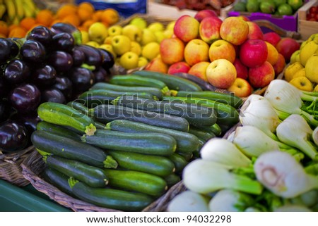 Open market shelves full of a different kinds of vegetables - stock photo