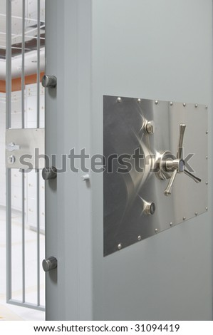 Open massive vault door in an deposit room - stock photo