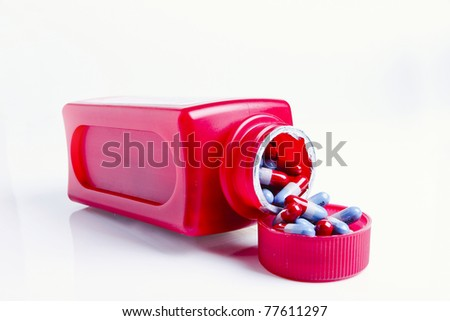 Open Medicine Bottle with Pills Spilling over isolated white - stock photo