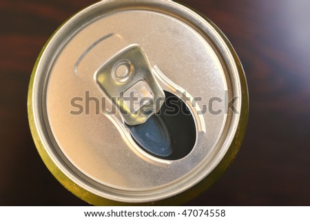 open metal can of beer photo above on a dark background