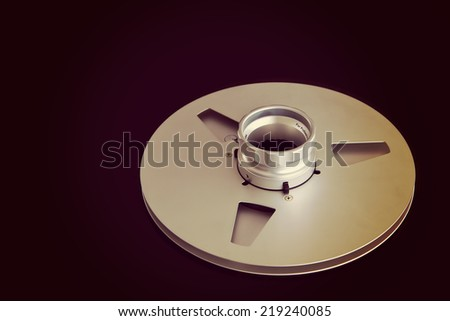 Open Metal Reels With Tape For Professional Sound Recording with NAB adapter - stock photo