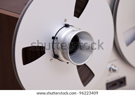 Open Metal Reels With Tape For Professional Sound Recording with NAB adapters - stock photo