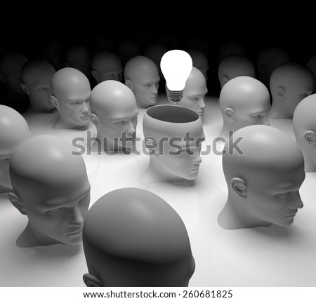 Open minded head with light bulb standing out from the rest - stock photo