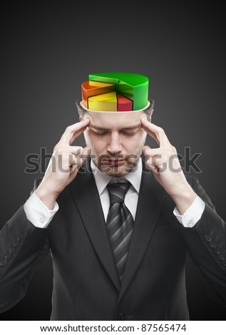 Open minded man with colorful  pie chart graph inside. Conceptual image of a open minded man. On a black background - stock photo