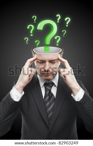 Open minded man with Green question marks inside.Conceptual image of a open minded man. - stock photo