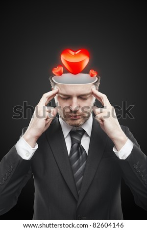 Open minded man with hearts inside thinking about the relationship. Conceptual image of a open minded man. - stock photo