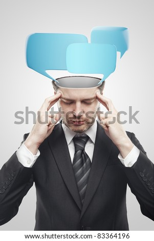 Open minded man with speech bubbles inside. Conceptual image of a open minded man. Isolated on a gray background - stock photo
