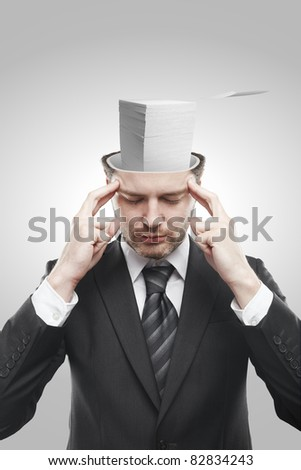 Open minded man with stack of papers inside thinking about work.Conceptual image of a open minded man. - stock photo