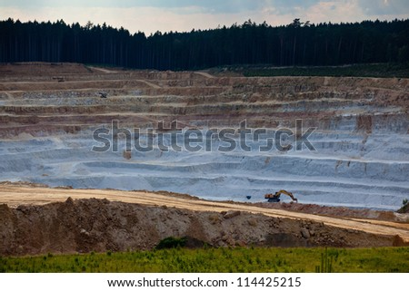 Open mine pit excavating glass sand - stock photo