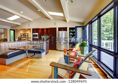Open modern luxury home interior living room and kitchen. - stock photo