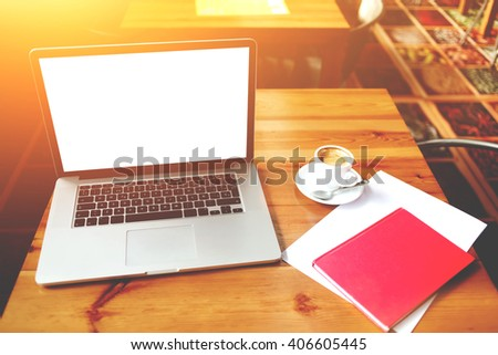 Open net-book with copy space screen for your information content or text message, electronic business distance work via internet, laptop computer and notepad with sheet of paper lying on a table  - stock photo