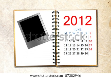 open note book with calendar 2012. Month is June.