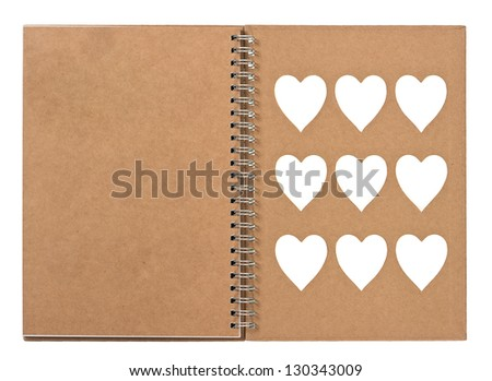 open note book with ring binder and white hearts on the cover. recycle paper