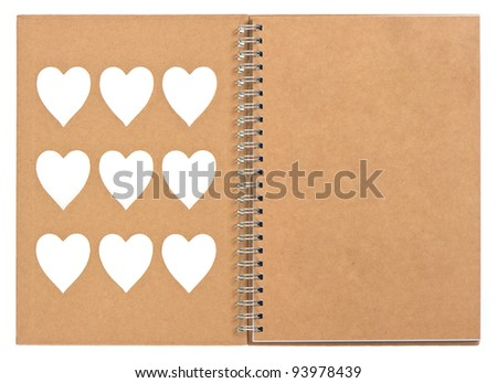 open note book with ring binder and white hearts on the cover. recycle paper - stock photo