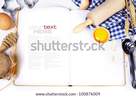 Open notebook and Basic baking ingredients (with easy removable sample text) - stock photo