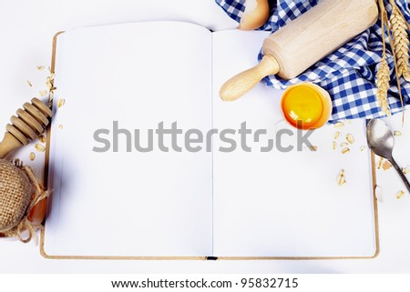 Open notebook and Basic baking ingredients (with space for text) - stock photo