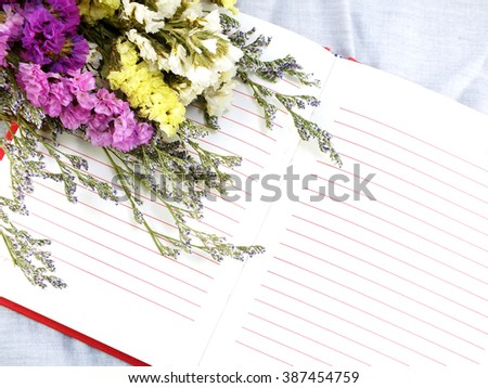 open notebook and beautiful statice flowers bouquet  with space for copy