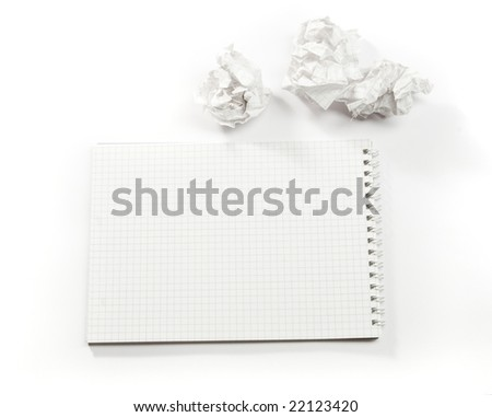Open notebook and crumpled paper on white ground - stock photo