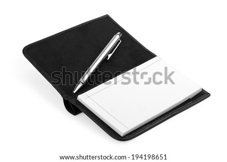 Open notebook and pen isolated on the white background - stock photo