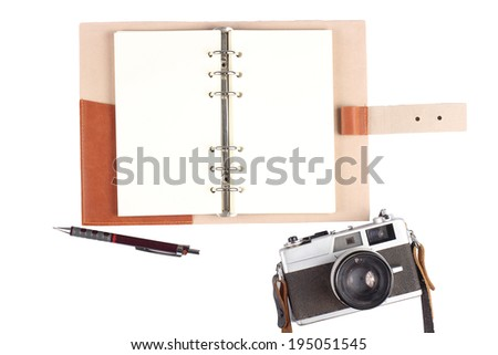 Open notebook and pen with camera isolated on white background , isolated on white  - stock photo