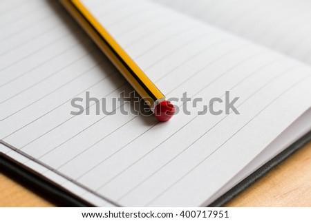 Open notebook and Pencil