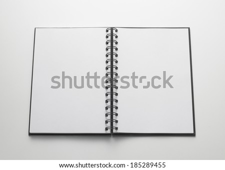 open notebook, bound ring with blank pages on white background - stock photo