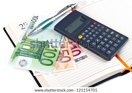 Open notebook, calculator, pen and money. Isolated on white - stock photo