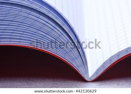Open notebook closeup - stock photo