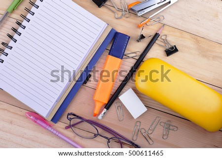 Open notebook, Free space for text. glasses On the desk. Top view. in Office