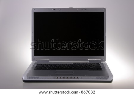 Open notebook laptop computer with wide screen and black keyboard. - stock photo