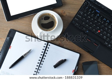 open notebook, mobile  phone,  pen and cup of coffee - stock photo