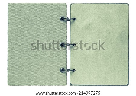 open notebook on a white background with a cover from fabric and with paper pages of green color