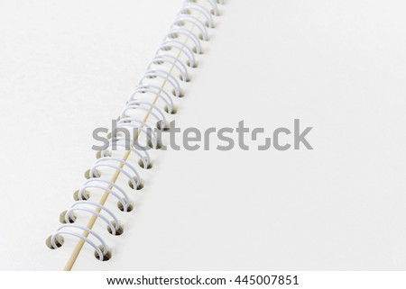 Open notebook on natural wood table. Closeup blank paper spiral notebook page. Notebook empty page with line background for design with copy space for text or image.