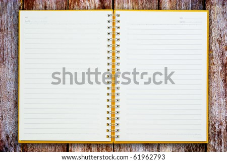 Open notebook on wood for background and text