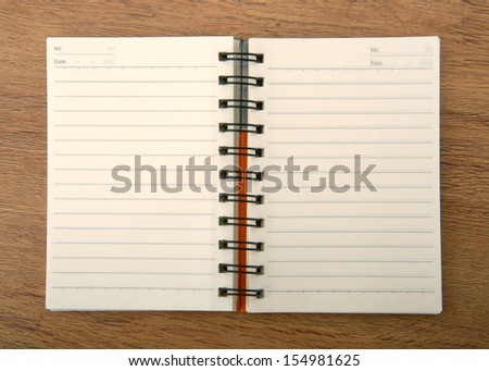 Open notebook on wooden background