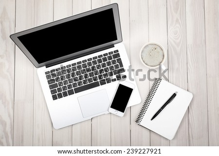 Open notebook, smart phone, diary and a cup of coffee on wooden background, top view - stock photo