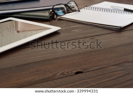 Open notebook, tablet computer, glasses, ballpoint and folders on the office desk. Free space for text. Copy space. Office workplace - stock photo