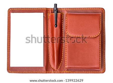 Open notebook with a pen on white - stock photo
