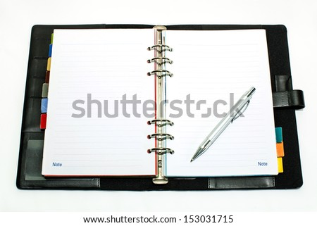 Open notebook with ballpoint pen. - stock photo