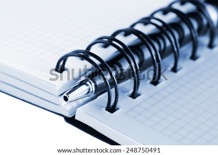 Open notebook with blank pages and pen, isolated on white background, blue tint