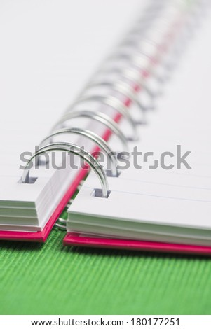 Open notebook with blank white ruled pages