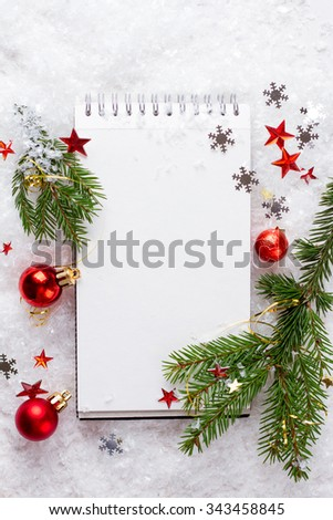 Open notebook with christmas decoration, selective focus - stock photo