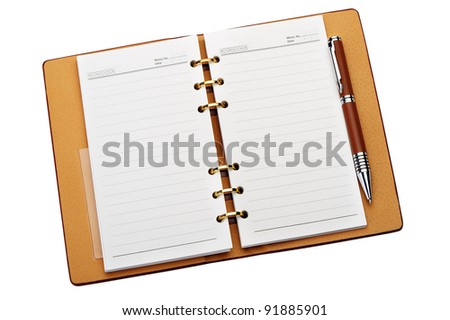 Open notebook with copper binding and stylish pen. It is isolated on a white background - stock photo