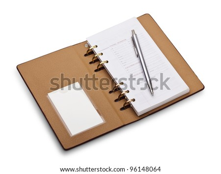 Open notebook with copper binding and stylish pen. It is isolated on a white background