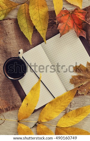 Open notebook with cup of coffee. Autumn time blank notebook