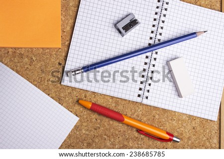 open notebook with pen and pencil on wooden table - stock photo