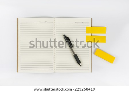 Open notebook with post it and pen on white background