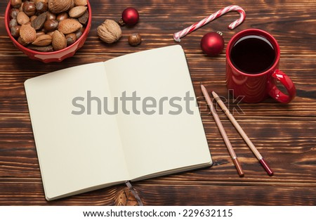Open Notepad. Cup Of Tea. Macaroon Cookies. Wooden Background.